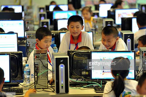 Chinese children attend a computer class to learn how to properly use the Internet in Beijing on June 7 2010 China defended its right to censor the...