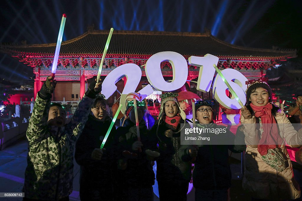 Chinese children celebrate the New Year during the New Year's Eve at Ancestral Temple on December 31 2015 in Beijing China China prepares a countdown...