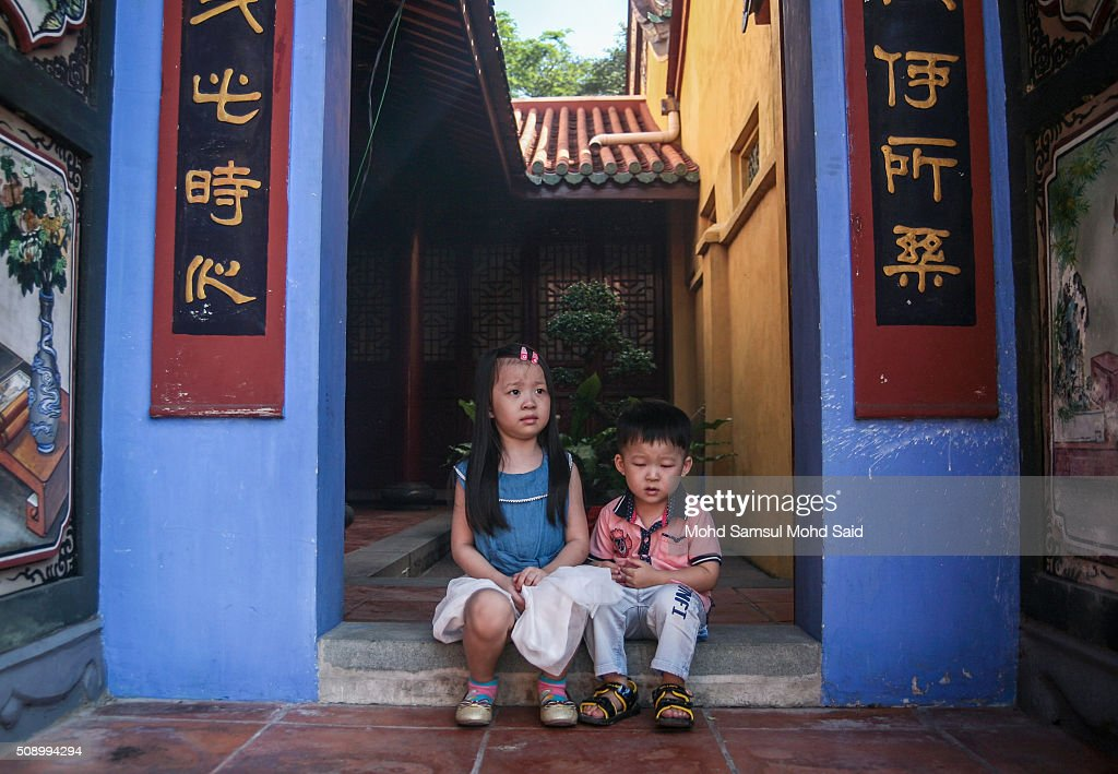 A Chinese childrens sits inside the Guan Yin temple during Lunar New Year of the monkey celebrations on February 8, 2016 outside Kuala Lumpur, Malaysia. According to the Chinese Calendar, the Lunar New Year which falls on February 8 this year marks the Year of the Monkey, the Chinese Lunar New Year also known as the Spring Festival is celebrated from the first day of the first month of the lunar year and ends with Lantern Festival on the Fifteenth day.