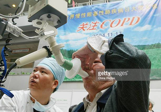 A Chinese citizen undergoes a free respiratory inspection on November 17 2004 in Nanjing China Today marks the World COPD Day The disease which can...