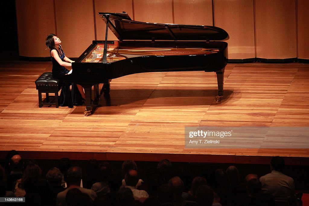 Chinese classical pianist Yuja Wang performs on stage during her evening solo piano recital, featuring works by composers Rachmaninov, Beethoven, Scriabin and Prokofiev, for the International Piano Series at Queen Elizabeth Hall at Southbank Centre on May 1, 2012 in London, United Kingdom.