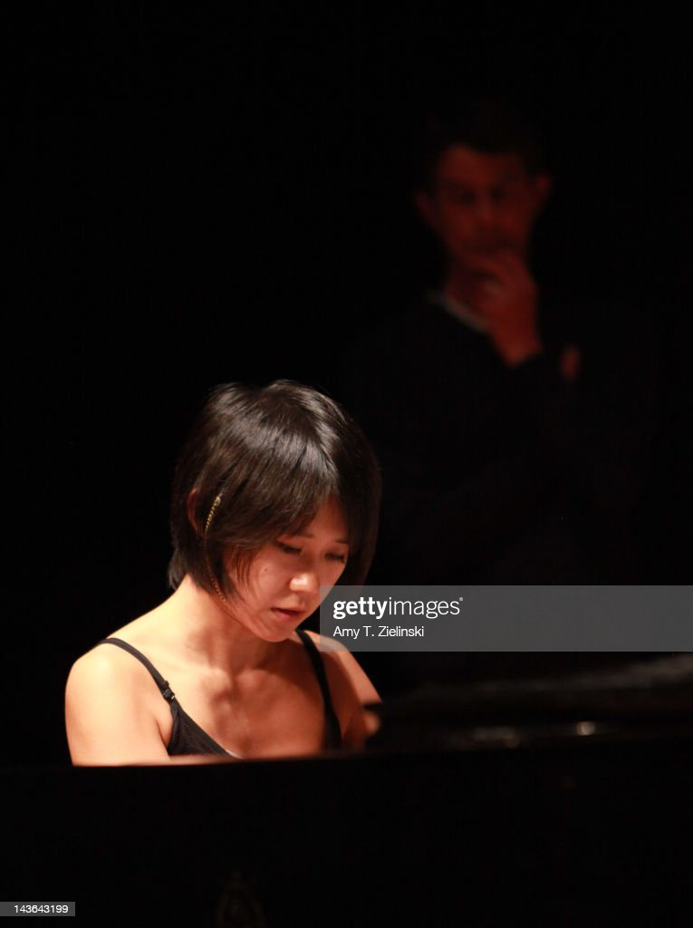Chinese classical pianist Yuja Wang rehearses on stage before her evening solo piano recital, featuring works by composers Rachmaninov, Beethoven, Scriabin and Prokofiev, for the International Piano Series at Queen Elizabeth Hall at Southbank Centre on May 1, 2012 in London, United Kingdom.