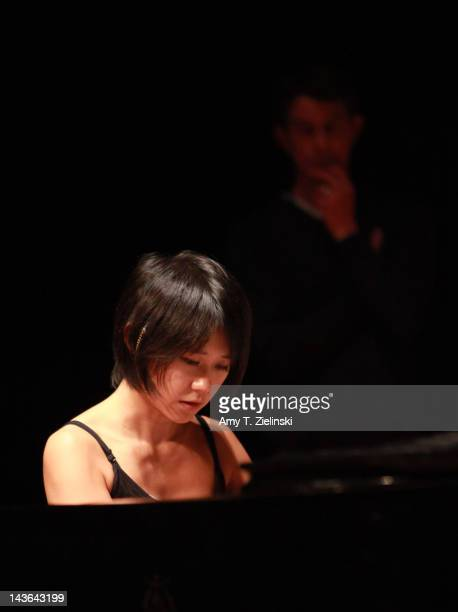 Chinese classical pianist Yuja Wang rehearses on stage before her evening solo piano recital featuring works by composers Rachmaninov Beethoven...