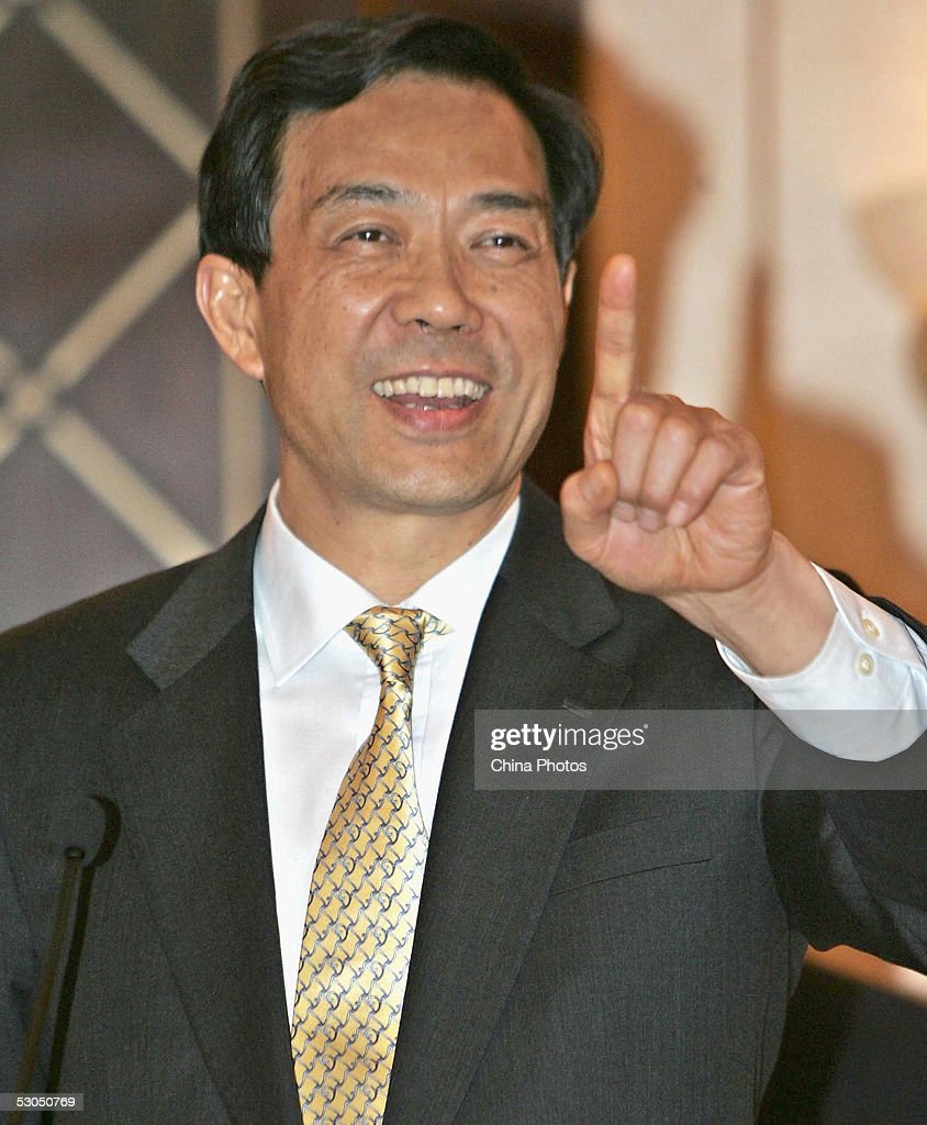 Chinese Commerce Minister Bo Xilai gestures at a press conference following the conclusion of talks between the European Union (EU) and China on June 11, 2005 in Shanghai, China. EU and China agreed on a deal that will manage the growth of Chinese textile imports to the EU until the end of 2008, said the EU executive arm European Commission.
