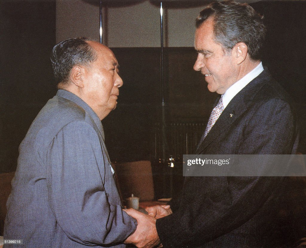 chinese communist leader chairman mao zedong welcomes us president richard nixon at his house in beijing