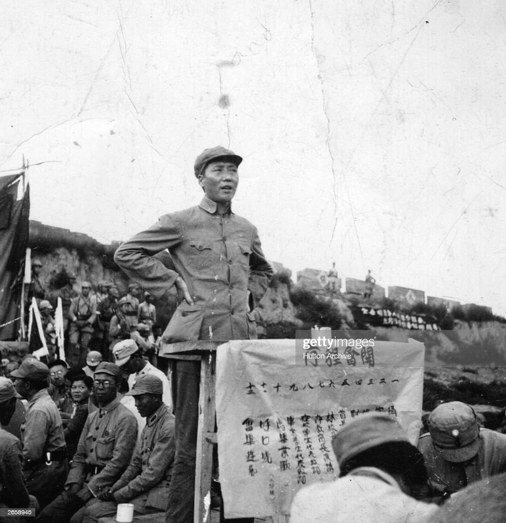 Chinese Communist leader Mao Zedong (1893 - 1976), better known as Mao Tse-tung, addresses a meeting calling for even greater efforts against the Japanese, at the Kangdah (Anti-Japanese) Cave University.
