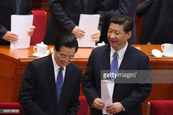 Chinese Communist Party chief and incomingPresident Xi Jinping and Chinese President Hu Jintao leave after the closing session of the annual Chinese...