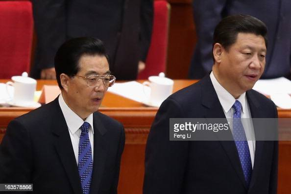 Chinese Communist Party chief and incomingPresident Xi Jinping and Chinese President Hu Jintao stand for the national anthem during the closing...