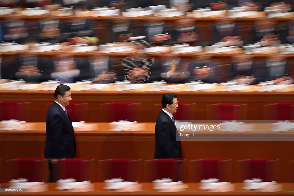 Chinese Communist Party chief and incoming-President Xi Jinping (L) walks behind Chinese President Hu Jintao (R) as they arrive for the closing session of the annual Chinese People's Political Consultative Conference (CPPCC) held at the Great Hall of the People on March 12, 2013 in Beijing, China. The newly-elected Chairman of the CPPCC Yu Zhengsheng pledged Tuesday that China will not copy Western political systems under any circumstances.