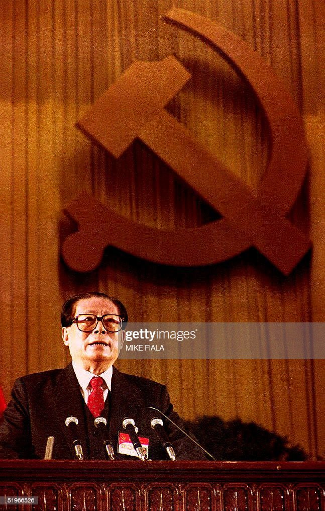 Chinese Communist Party General Secretary <a gi-track='captionPersonalityLinkClicked' href=/galleries/search?phrase=Jiang+Zemin&family=editorial&specificpeople=159399 ng-click='$event.stopPropagation()'>Jiang Zemin</a> delivers his report to the opening of the 14th Party Congress 12 October, 1992 in Beijing. The report will give the stamp of approval for speeding up economic reforms and will formally endorse the shift to a planned market economy.