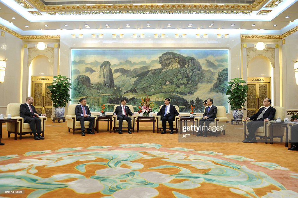 Chinese Communist Party General Secretary Xi Jinping (3rd R) meets with Vuk Jeremic (3rd L), president of the 67th Session of the UN General Assembly, at the Great Hall of the People in Beijing on December 27, 2012. Jeremic is paying an official visit to China from December 26 to 28.