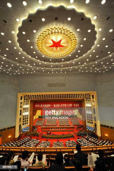 Chinese Communist Party members and delegates attend a plenary session of the National People's Congress at the Great Hall of the People in Beijing...