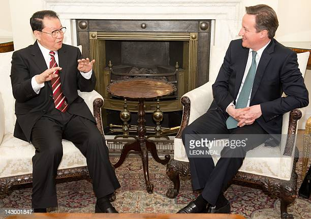 Chinese Communist Party official Li Changchun gestures as he speaks as British Prime Minister David Cameron listens during their meeting at Downing...