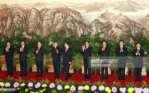 Chinese communist party's new leadership team Hu Jintao waves while others Zhou Yongkang Li Keqing Li Changchun Wen Jiabao Wu Bangguo Jia Qinglin Xi...
