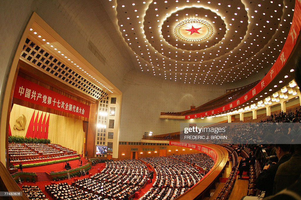 Chinese Communists wrap up their 17th five-yearly Party Congress inside the Great Hall of the People in Beijing, 21 October 2007, beneath the red star rooftop. China's Communist Party ended its Congress after amending its charter to include President Hu's vision for the nation and endorsing leadership changes after Hu declared the event over in a short ceremony to mark the end of the week-long meeting that gathered more than 2,200 top cadres in Beijing. AFP PHOTO/Frederic J. BROWN