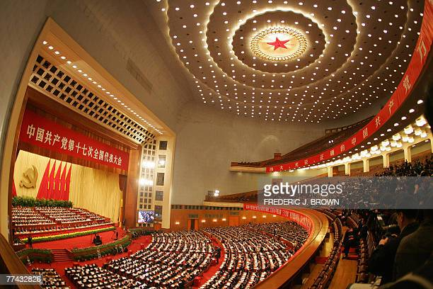 Chinese Communists wrap up their 17th fiveyearly Party Congress inside the Great Hall of the People in Beijing 21 October 2007 beneath the red star...