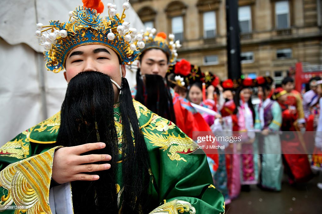Chinese community of Glasgow dress in traditional costumes to celebrate The Year of The Monkey on February 7, 2016 in Glasgow, Scotland. The first ever Chinese New Year celebrations to be held in George Square, The Year of the Monkey begins on February 8th and lasts until January 27, 2017.