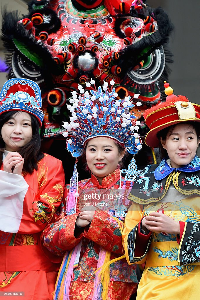 Chinese community of Glasgow dressed in traditional costumes celebrate The Year of The Monkey on February 7, 2016 in Glasgow, Scotland. The first ever Chinese New Year celebrations to be held in George Square, The Year of the Monkey begins on February 8th and lasts until January 27, 2017.