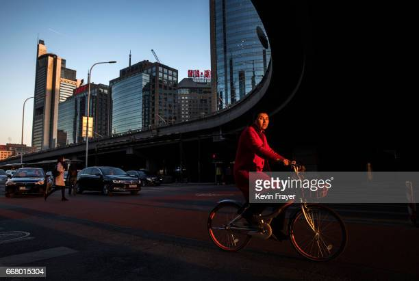 Chinese commuter rides a bike share during rush hour on March 27 2017 in Beijing China The popularity of bike shares has exploded in the past year...
