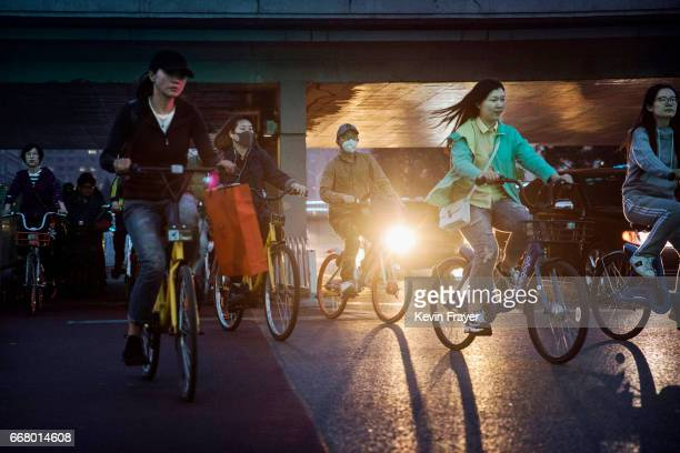 Chinese commuters ride bike share during rush hour on April 6 2017 in Beijing China The popularity of bike shares has exploded in the past year with...