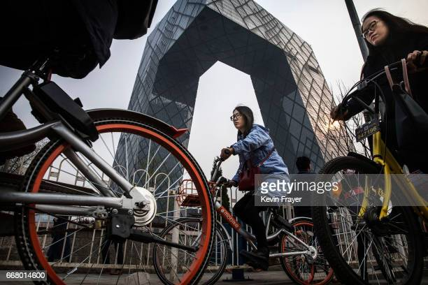 Chinese commuters ride bike share during rush hour on March 30 2017 in Beijing China The popularity of bike shares has exploded in the past year with...