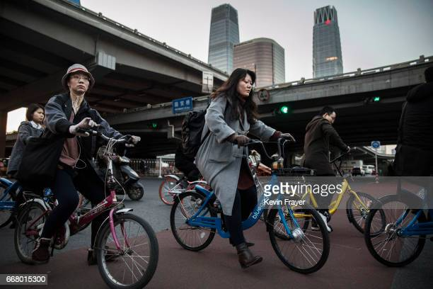 Chinese commuters ride bike shares during rush hour on March 27 2017 in Beijing China The popularity of bike shares has exploded in the past year...