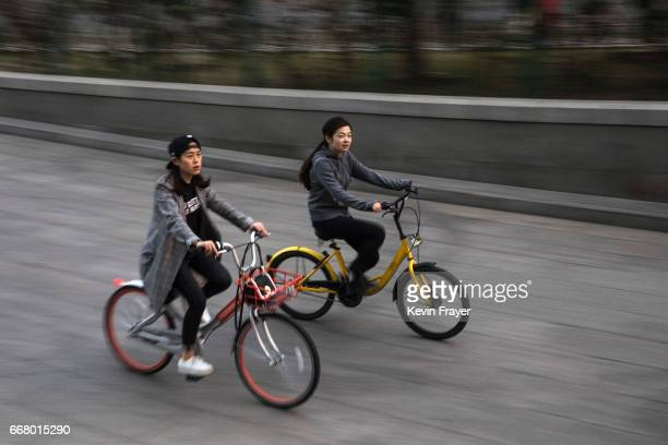 Chinese commuters ride bike shares during rush hour on March 28 2017 in Beijing China The popularity of bike shares has exploded in the past year...