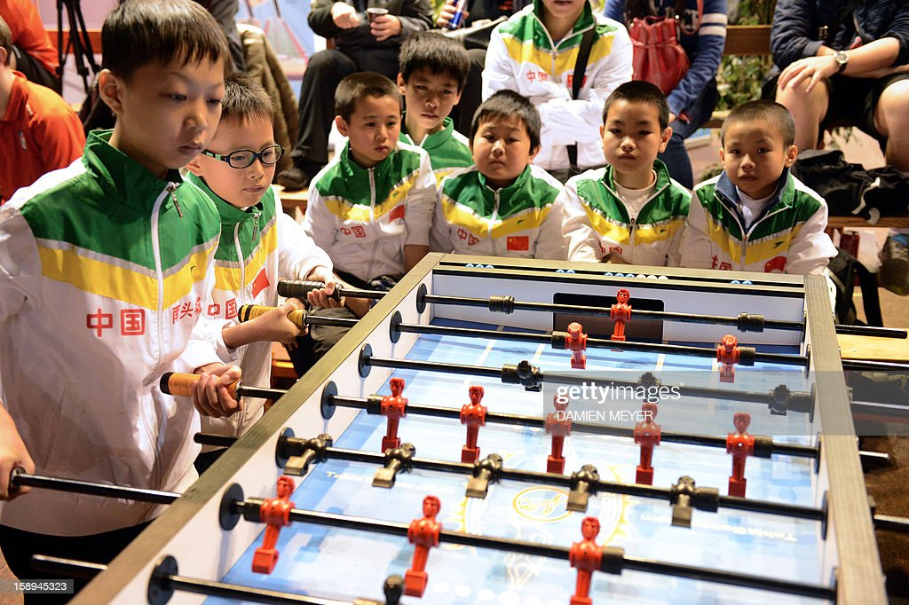 Chinese competitors attend the ITSF 2013 table soccer (aka babyfoot) World Cup on January 4, 2013 in Nantes, western France.