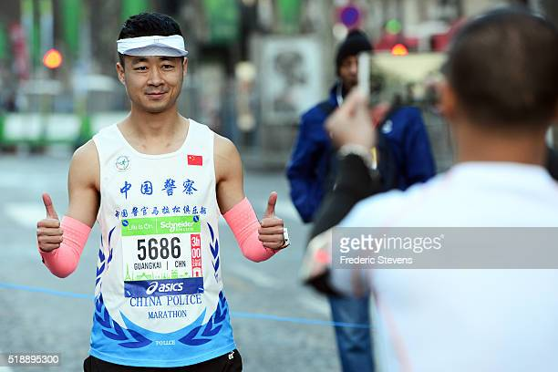 Chinese competitors starts on the Champs Elysees avenue for the 40th Paris Marathon crossing the French capital on April 3 2016 in Paris France 57000...