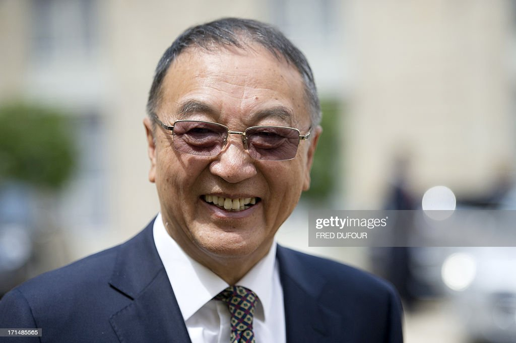Chinese computer giant Lenovo chairman Liu Chuanzhi leaves the Elysee presidential Palace on June 25, 2013 in Paris after a meeting with French president. AFP PHOTO / FRED DUFOUR