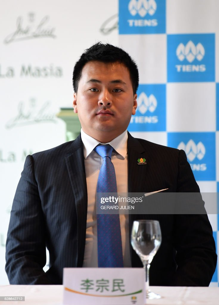Chinese conglomerate Tiens' Director of the Management Board, Li Zongmin (son of the group founder, Chinese tycoon Li Jinyuan) poses prior giving a press conference in Madrid on May 6, 2016. Some 2,500 employees of Chinese conglomerate Tiens arrived in Spain on May 4, 2016 for an all-paid holiday treat complete with a giant paella and sangria party, in a trip costing a grand total of seven million euros ($8 million) hailed as helping the ailing local economy. JULIEN