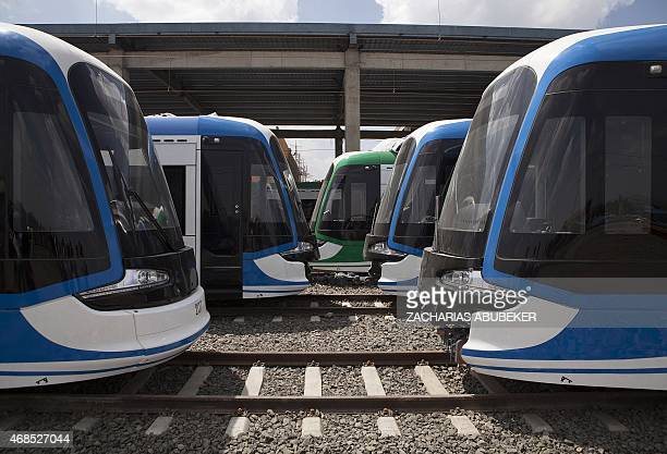 Chinese constructed light rail trains are pictured at the Kality Depot in Addis Ababa on April 3 2015 The train line the first in subSaharan Africa...