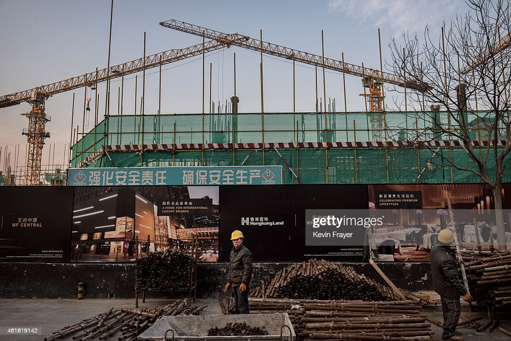 Chinese construction worker at work on January 20, 2015 in central Beijing, China. China's economic growth slowed to its weakest point in years to 7.4 percent. While its growth is stronger than most world economies, China announced Tuesday a strategy to encourage domestic consumption including retail spending in an effort to boost growth.