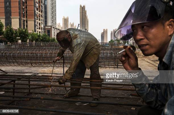 Chinese construction worker welds steel at a construction site for a new development on May 14 2017 in Wuhan Hubei province China