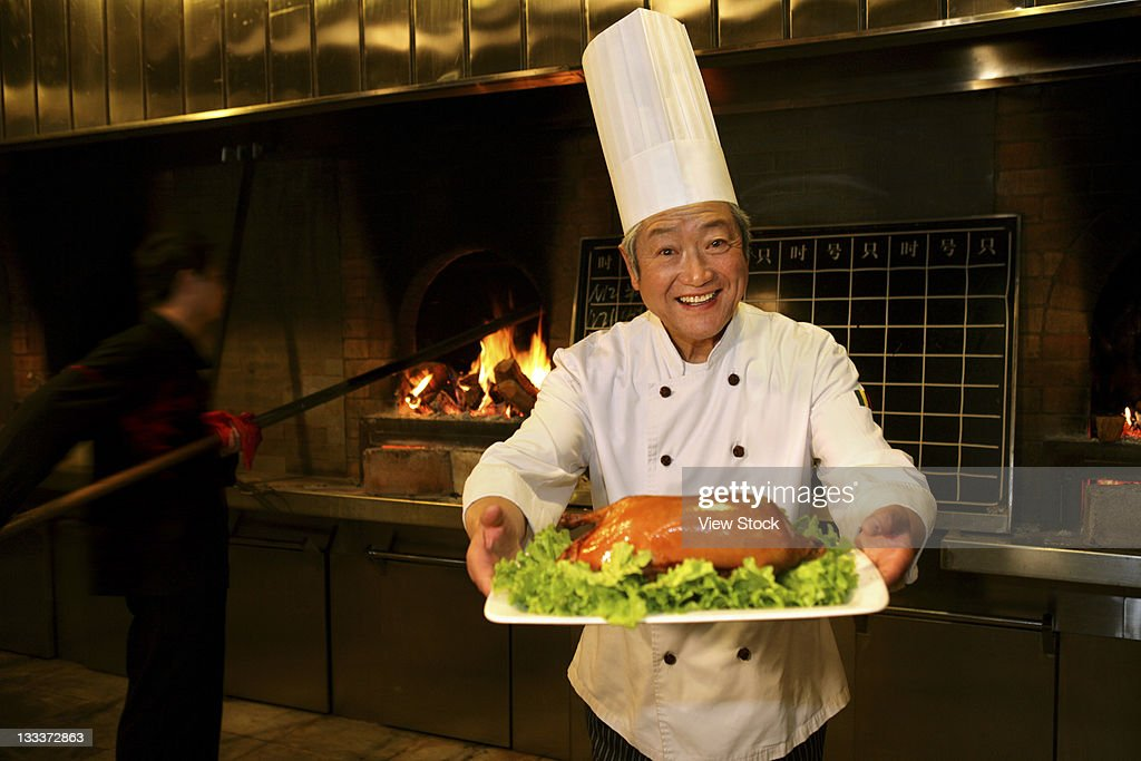 Chinese Cook Cooking Beijing Duck : Stock Photo