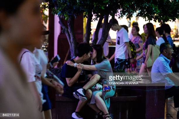 A Chinese couple embraces during the Qixi Festival or Chinese Valentine's Day in Shanghai on August 28 2017 While Valentine's Day is on February 14...