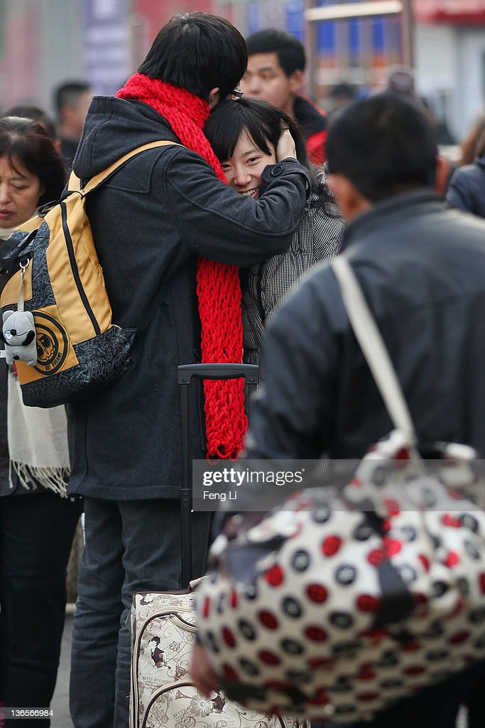 A Chinese couple hug outside Beijing West Railway Station on January 8, 2012 in Beijing, China. China's annual Spring Festival travel rush begins on Sunday, and authorities estimate 3.158 billion passenger journeys will be made for the Chinese lunar new year during the 40-day travel period.