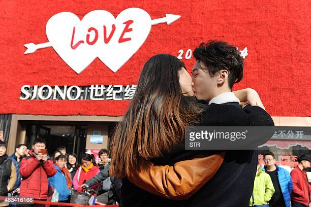 A Chinese couple kisses during a kissing contest on Valentine's Day in Jinan China's Shandong province on February 14 2015 The contest prize was a...