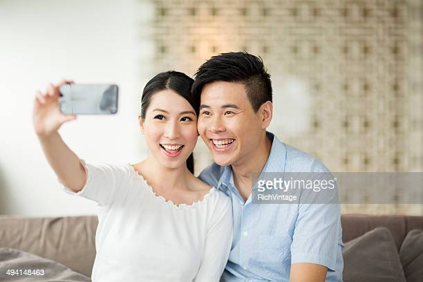 Chinese Couple Posing for Smart Phone Selfie