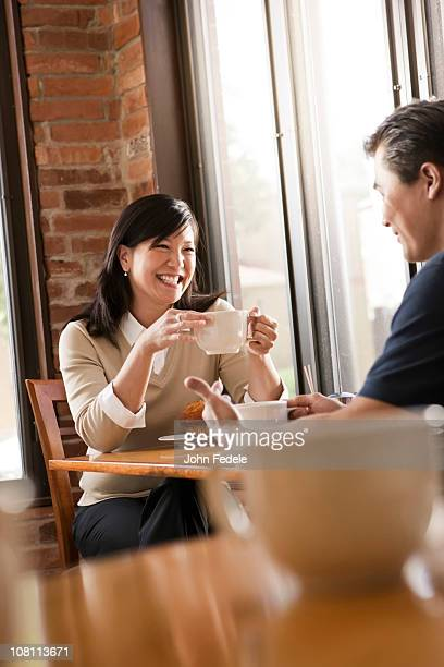 Chinese couple relaxing in cafe