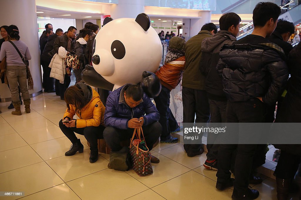 A Chinese couple rest and look the smartphone in a shopping mall on the fourth day of the Chinese Lunar New Year of Horse on February 3, 2014 in Beijing, China. The Chinese Lunar New Year of Horse also known as the Spring Festival, which is based on the Lunisolar Chinese calendar, is celebrated from the first day of the first month of the lunar year and ends with Lantern Festival on the Fifteenth day.