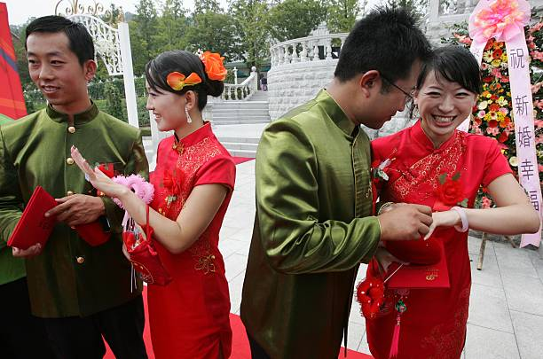 Chinese Couples Attend A Mass Wedding Ceremony At Everland Amusement Park On September 20 2006
