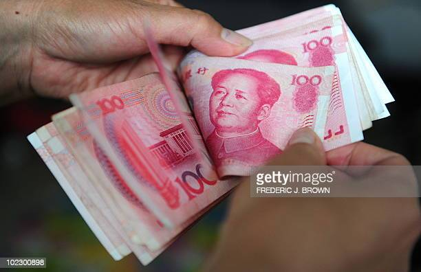 Chinese currency 100 Yuan notes are counted in Beijing on June 22 2010 China's central bank has taken its first concrete step toward honouring a...