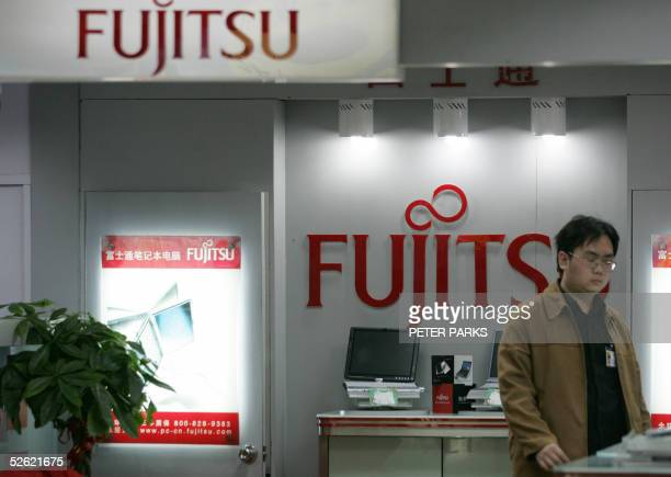 Chinese customer looks at Japanese Fujitsu computers in a store in Beijing 13 April 2005 Senior officials from Japan China and South Korea are in...
