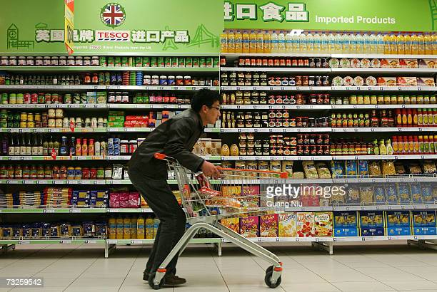 Chinese customer shops at the newlyopened Tesco supermarket on February 8 2007 in Beijing China The UK giant opened its first ownbrand supermarket in...
