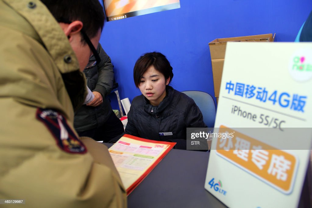 A Chinese customer signs up early on January 17, 2014 to purchase the IPhones with 4G (fourth generation) network at a China Mobile outlet in Nanjing, in eastern China's Jiangsu province. China Mobile, the country's biggest services provider, started selling Apple's iPhone to its millions of customers nationwide, ending a six-year wait in a key market for the US technology giant. CHINA