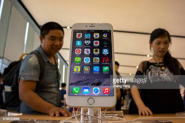 Chinese customers are experiencing and choosing Apple's products in an Apple store beside West lake in Hangzhou which is the biggest Apple store in...