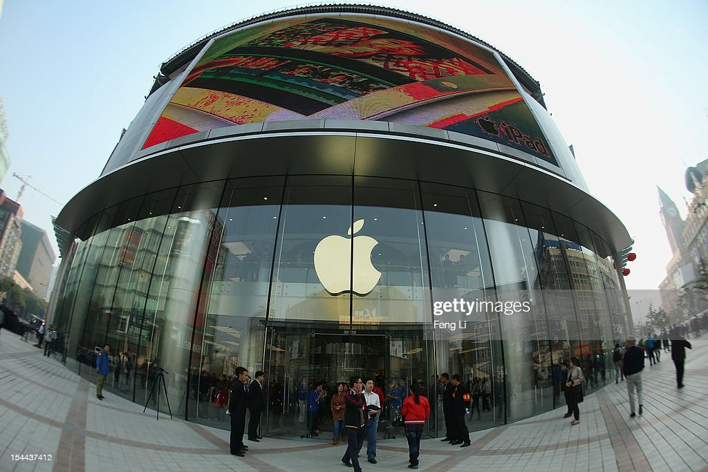 Chinese customers enter the newly opened Apple Store in Wangfujing shopping district on October 20, 2012 in Beijing, China. Apple Inc. opened its sixth retail store on the Chinese mainland Saturday. The new Wangfujing store is Apple's largest retail store in Asia.