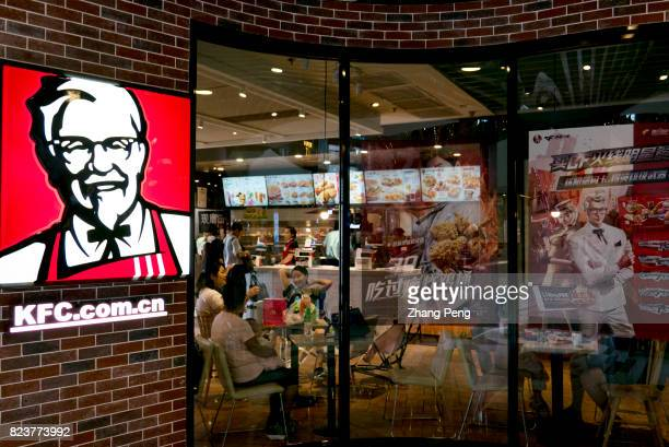 Chinese customers in a KFC restaurant On the store window is a sales promotion in conjunction a Tencent mobile game Due to the slowdown in the...