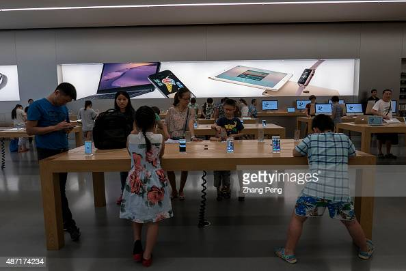JIEFANGBEI CHONGQING CHINA Chinese customers in an Apple store in Chongqing Apple has experienced strong growth for the business in China through...
